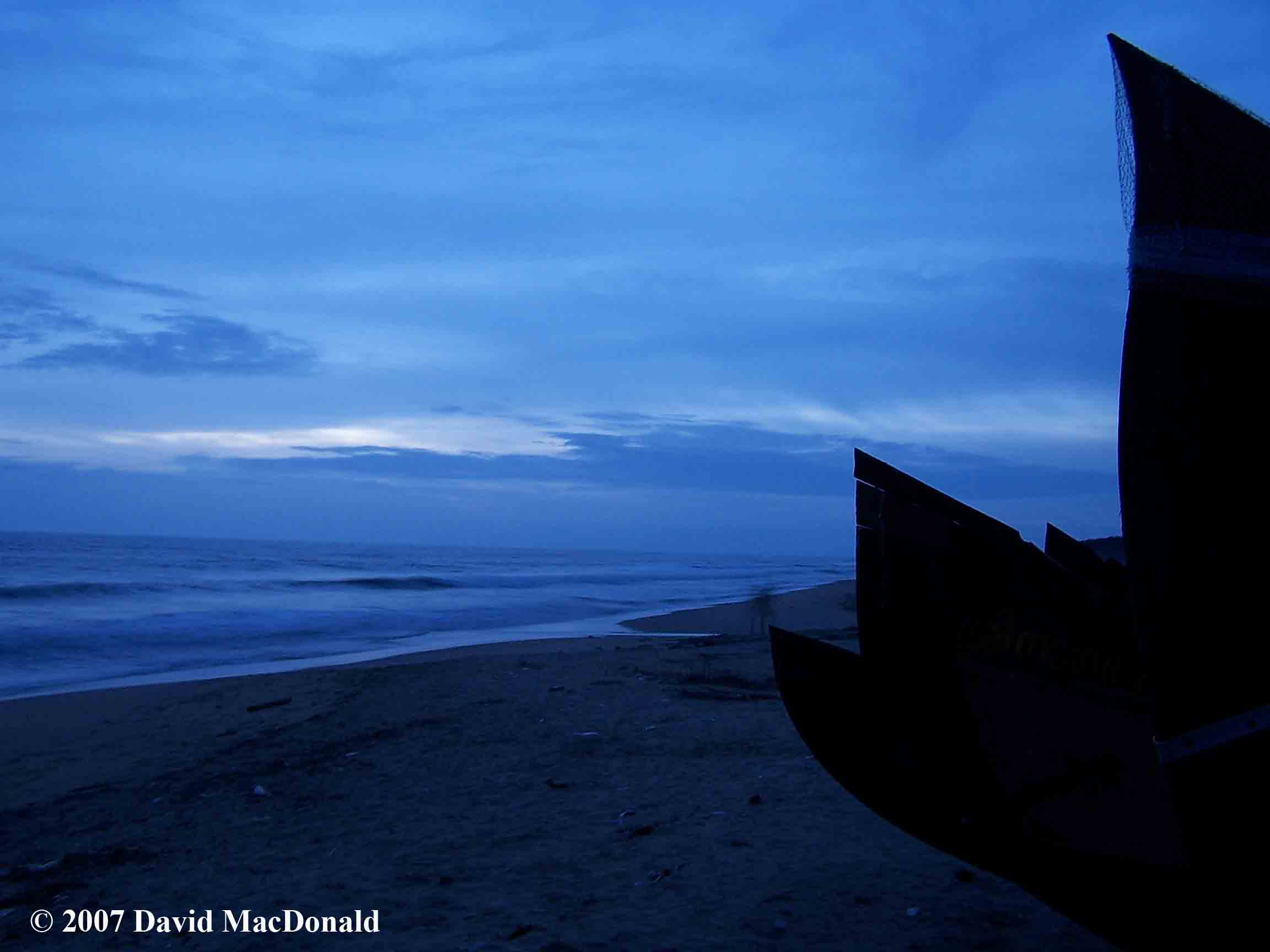 Indian fishing boats on the beach of the Arabian Sea at dusk